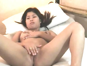Asian,Masturbation,Milf,Panties,Solo Session as the Asian babe rubs on her...